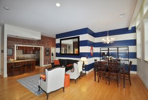 Eclectic Great Room with Oak - Butterrum 2 1/4 in. Solid Hardwood Strip, Barton Wingback Chair, Chandelier, interior brick