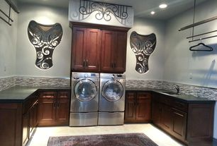 Eclectic Laundry Room with laundry sink, can lights, Undermount sink, Hanging Bar, stone tile floors, Standard height