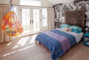 Eclectic Kids Bedroom with Transom window, Anthropologie knotted melati hanging chair, Hardwood floors, French doors