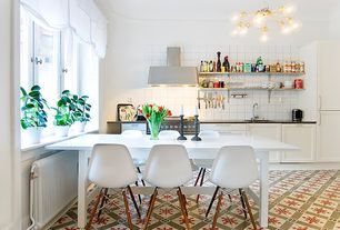 Contemporary Kitchen with Soapstone counters, Large Ceramic Tile, Flat panel cabinets, Flush, Breakfast nook, L-shaped