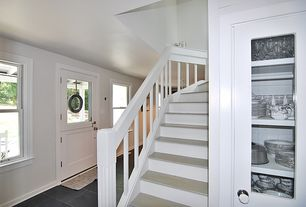 Cottage Staircase with High ceiling, Hardwood floors
