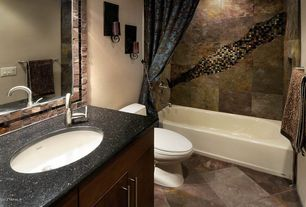 Eclectic Full Bathroom with Stone Tile, shower bath combo, European Cabinets, Simple granite counters, drop in bathtub, Flush