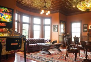 Traditional Home Office with flush light, Crown molding, Refurbished pinball machine, Chandelier, Hardwood floors