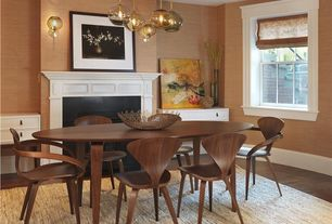 Traditional Dining Room with metal fireplace, interior wallpaper, Built-in bookshelf, Hardwood floors, Wall sconce