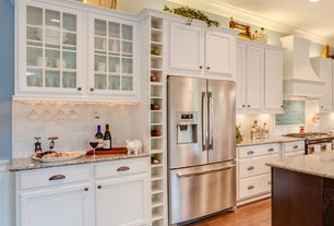 Traditional Kitchen with Custom hood, can lights, Simple granite counters, One-wall, Glass panel, gas range, Paint
