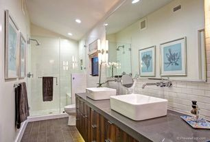 Eclectic Master Bathroom with European Cabinets, Double sink, frameless showerdoor, Wall sconce, stone tile floors, Shower