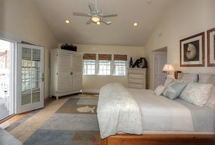 Cottage Master Bedroom with flush light, High ceiling, Ceiling fan, Built-in bookshelf, French doors, Hardwood floors