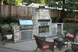 Traditional Patio with Raised beds, exterior tile floors, Outdoor kitchen, outdoor pizza oven, Fence
