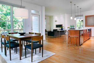 Contemporary Great Room with Pendant light, Transom window, French doors, Hardwood floors, Columns
