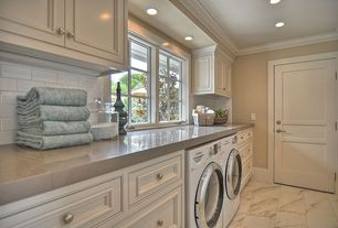 Traditional Laundry Room with Cabot porcelain tile - pietra series calacatta, Crown molding, terracotta tile floors