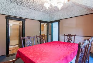 Craftsman Dining Room with specialty door, Standard height, Chair rail, Crown molding, Carpet, Chandelier