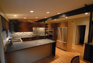 Kitchen with electric cooktop, Undermount sink, Slate counters, U-shaped, Specialty Tile, Multiple Refrigerators, can lights