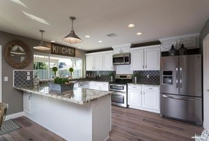 Transitional Kitchen with Complex granite counters, U-shaped, Hardwood floors, Stone Tile, specialty door, Raised panel