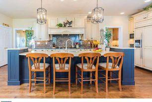 Country Kitchen with specialty door, Breakfast bar, Flush, Custom hood, Hardwood floors, Simple granite counters, L-shaped