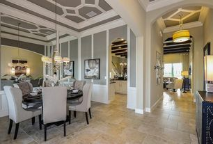 Eclectic Dining Room with Wainscotting, travertine floors, Crown molding, Chandelier