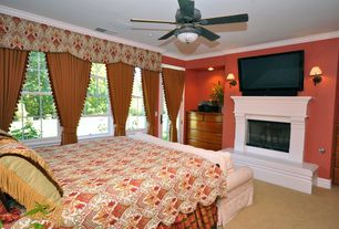 Traditional Guest Bedroom with Ceiling fan, Carpet, Wall sconce, French doors, Crown molding