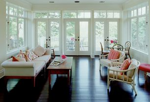 Traditional Living Room with Hardwood floors, French doors, Crown molding, Transom window