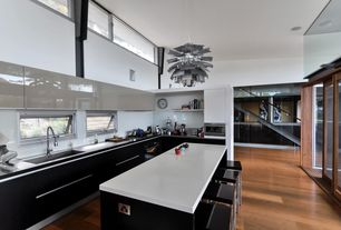 Contemporary Kitchen with PH Artichoke Lamp, Chandelier, Undermount sink, L-shaped, Corian counters, High ceiling, Flush