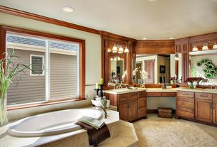 "Traditional Master Bathroom with Raised panel, Reliance Whirlpools Oval 72.5"" x 36.38"" Soaking Bathtub, Crown molding"
