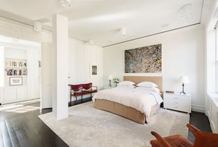 Contemporary Master Bedroom with Wall sconce, Paint 1, can lights, Standard height, Laminate floors, Columns