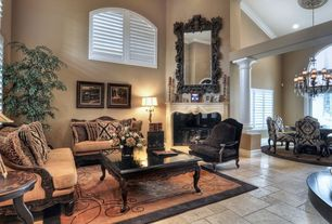 Traditional Living Room with Columns, stone fireplace, Arched window, High ceiling, limestone floors