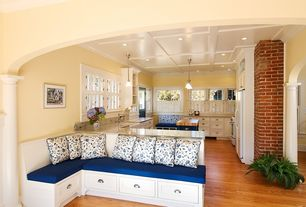 Country Great Room with Chandelier, Pendant light, Crown molding, Hardwood floors, interior brick, Columns, Box ceiling