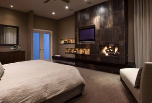 Contemporary Master Bedroom with Ceiling fan, Carpet, can lights, French doors, Standard height, Built-in bookshelf