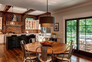 Eclectic Dining Room with sliding glass door, Hardwood floors, Pendant light, Standard height, Crown molding, Paint