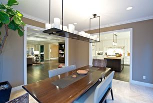 Contemporary Dining Room with Crown molding, travertine tile floors, Standard height, Pendant light, can lights