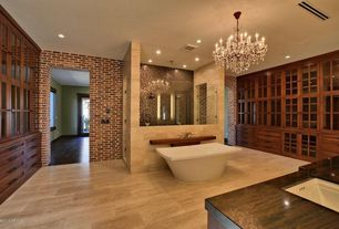 Contemporary Master Bathroom with Built-in bookshelf, interior brick, Vieux quartier crystal chandelier, Chandelier