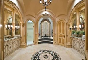 Mediterranean Master Bathroom with Undermount sink, Inlaid marble medallion, Flush, specialty door, Chandelier, High ceiling
