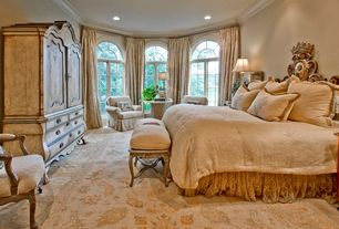 Mediterranean Master Bedroom with can lights, Standard height, Carpet, Paint 1, Aico armoire tuscano, Crown molding, Casement