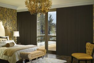 Traditional Master Bedroom with Chandelier, interior wallpaper, travertine tile floors, Crown molding, French doors