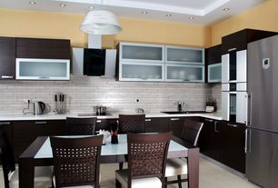 Contemporary Kitchen with travertine tile floors, stone tile floors, double wall oven, can lights, Pendant light, Wall Hood