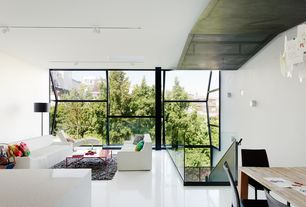 Contemporary Great Room with Concrete floors