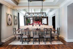 Contemporary Dining Room with Standard height, can lights, Crown molding, Hardwood floors, Pendant light