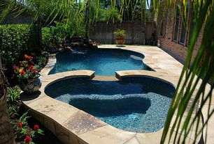 Rustic Swimming Pool with exterior stone floors, Pool with hot tub, double-hung window, Fence