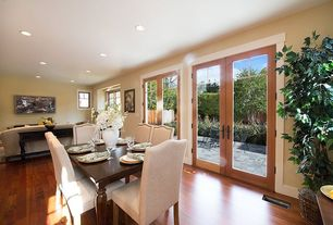 Craftsman Dining Room with Hardwood floors, French doors