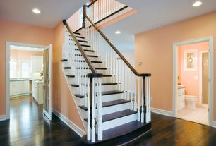 Traditional Staircase with High ceiling, Hardwood floors, curved staircase