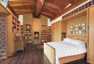 Eclectic Master Bedroom with Built-in bookshelf, Hardwood floors, Exposed beam, Cathedral ceiling, Area rug, Reading nook