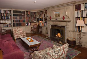 Traditional Living Room with Crown molding, Built-in bookshelf, Wall sconce, Chair rail, Hardwood floors
