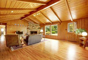 Rustic Living Room with picture window, Standard height, Hardwood floors, Exposed beam, flush light, Fireplace, Dutch door