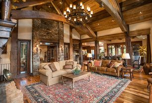 Rustic Living Room with Exposed beam, Wall sconce, Cosmo Wood with Iron Trim Coffee Table, Columns, Chandelier, Wood column