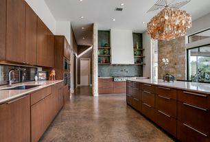 Modern Kitchen with Undermount sink, Capiz Shells Chandelier Z-Gallerie Gold, Ceramic Tile, European Cabinets, Breakfast bar