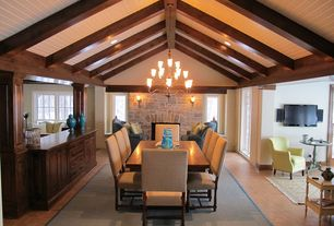 Modern Dining Room with Chandelier, Wall sconce, Hardwood floors, High ceiling, Exposed beam