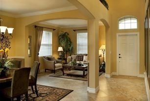 Traditional Living Room with travertine tile floors, Crown molding
