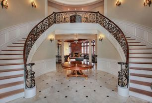 Traditional Staircase with High ceiling, Hardwood floors, Wall sconce, Double staircase, Wainscotting, Paint