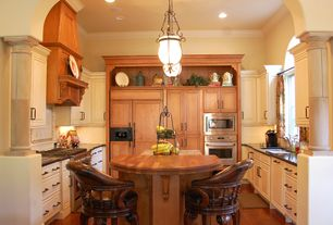 Traditional Kitchen with Custom hood, full backsplash, can lights, Pendant light, Soapstone counters, Casement, U-shaped
