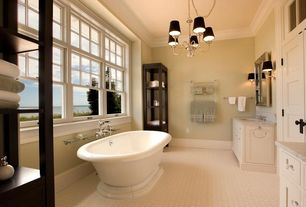 Traditional Master Bathroom with penny tile floors, specialty door, Chandelier, Complex marble counters, Master bathroom