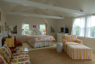 Cottage Guest Bedroom with Wall sconce, Hardwood floors, Exposed beam, Built-in bookshelf, Standard height, Ceiling fan